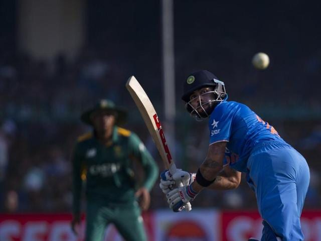 India's Virat Kohli gives a catch as he gets out during the first one day international cricket match against South Africa in Kanpur.