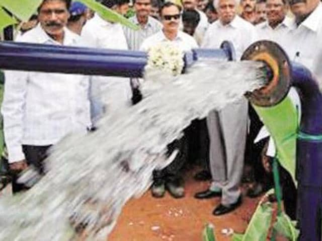 Residents of Ram Nagar display a contaminated water bottle in Patiala on Sunday.