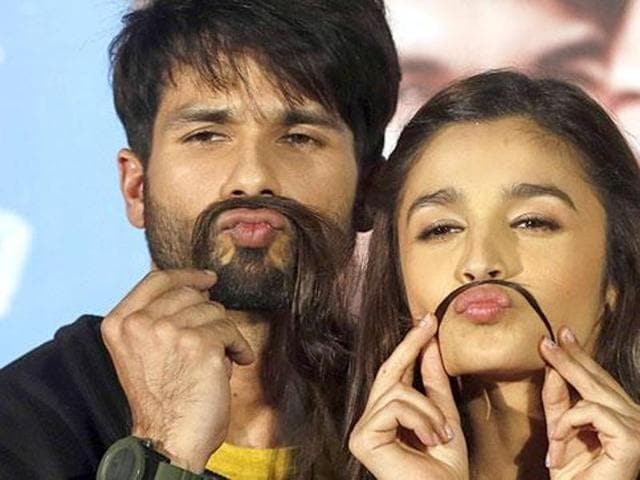Shahid Kapoor tries Alia Bhatt's hair for his moustache during the trailer launch of Shaandaar in Mumbai.