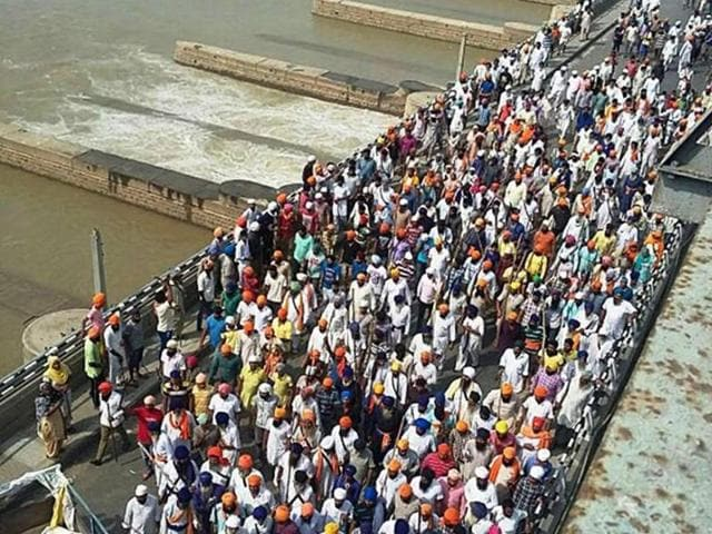 Sikh protesters block the Harike bridge during protests against the state government demanding arrest of those behind the sacrilege of Guru Granth Sahib on Sunday.