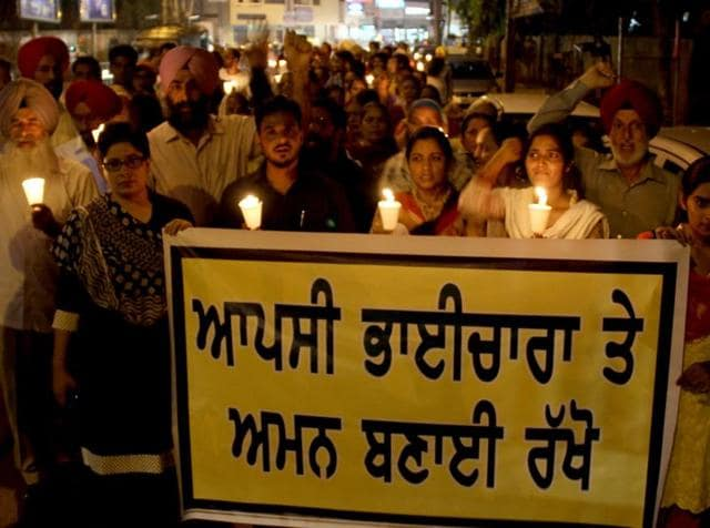 Various societies participating in a  candle light vigil  in Bathinda on Friday.