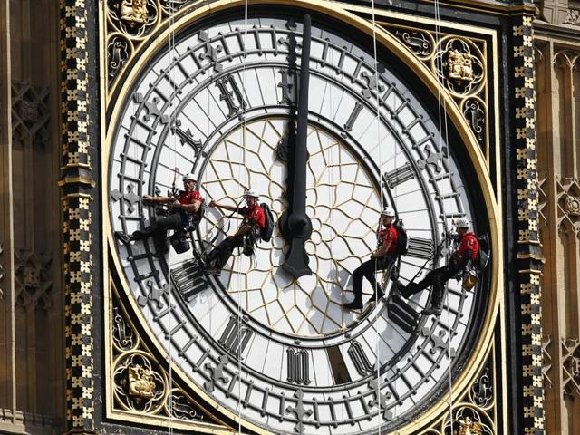 In this file photo, workers abseil outside the clock face as they clean Big Ben's clock tower of the Houses of Parliament in London. According to reports, the chimes of Big Ben may fall silent for many months as urgent repairs are carried out to the clock and the tower, which must begin as soon as possible.