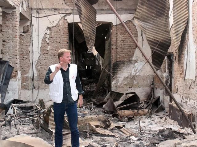 In this Friday, Oct. 16, 2015 photo, Christopher Stokes, the general director of the medical charity, Doctors Without Borders stands amid the charred remains of the organization's hospital, after it was hit by a US airstrike in Kunduz, Afghanistan.