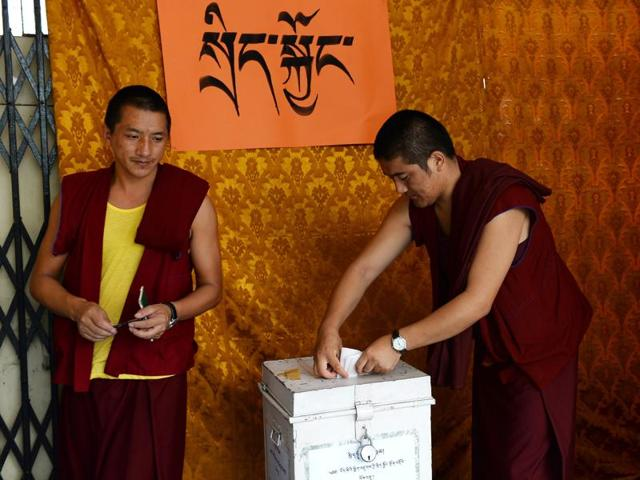 Tibetan monks cast their votes in an election for the Parliament of the Tibetan government-in-exile at a polling station in New Delhi.