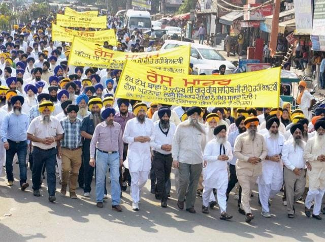 Members of the SGPC (Shiromani Gurdwara Parbandhak Committee) take out a march during their protest against the alleged desecration of religious book and the firing incident, in Amritsar.