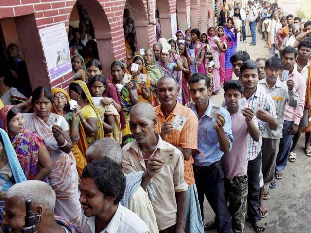 Voters wait in queues to cast their vote at a polling station during the second phase of Bihar assembly elections at Jehanabad on Friday.(PTI Photo)