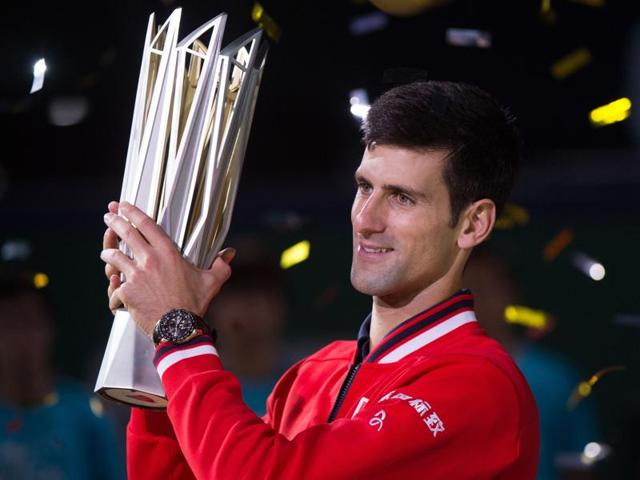 Novak Djokovic, left, of Serbia celebrates after beating Jo-Wilfried Tsonga of France in the final of the Shanghai Masters in Shanghai on October 18, 2015.