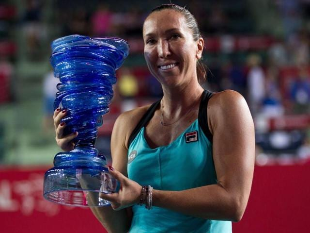 Serbia's Jelena Jankovic celebrates with the championship trophy after beating Germany's Angelique Kerber in the final of the WTA Hong Kong Open in Hong Kong, on October 18, 2015.