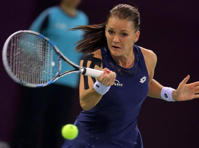 Agnieszka Radwanska of Poland hits a return against Elizaveta Kulichkova of Russia during the quarterfinal match of the Tianjin Open in Tianjin, China, on October 16, 2015.