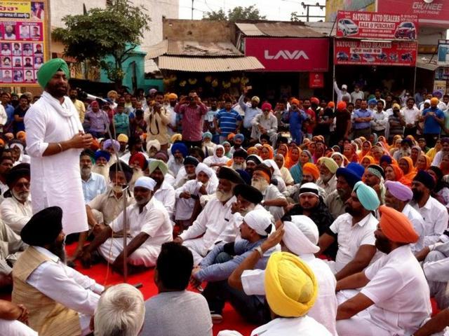 Congress spokesperson Sukhpal Singh Khaira addressing a massive protest at Nadala in Kapurthala on Monday.