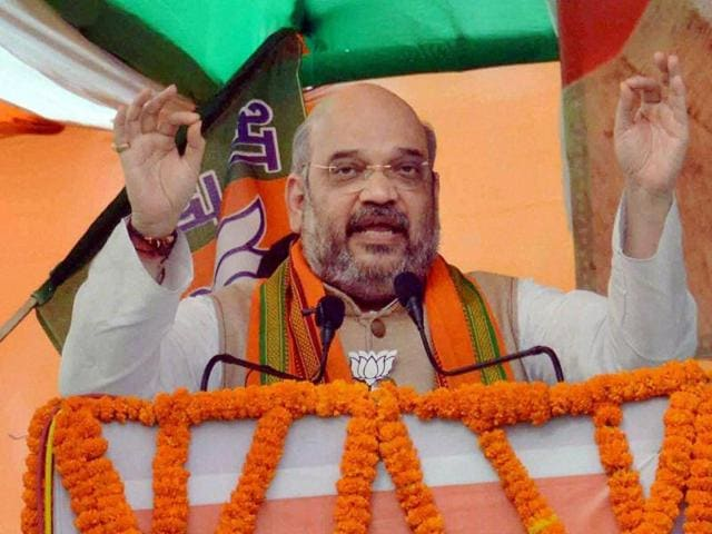 BJP President Amit Shah addressing the party workers meeting in Patna on Saturday.