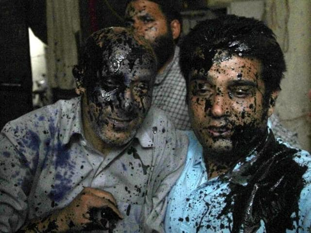 Jammu and Kashmir MLA Engineer Rashid (left) after an ink attack in New Delhi.