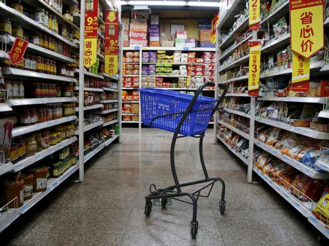 An empty shopping cart is seen at a branch store of Wal-Mart.
