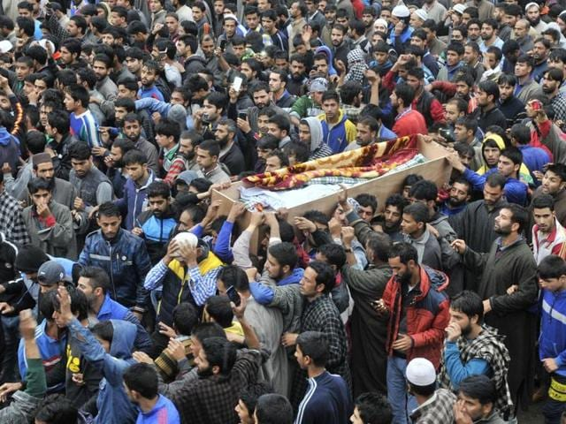 Kashmiri villagers carry the coffin of Zahid Ahmed during the funeral procession at his home at Batangoo village on Monday.