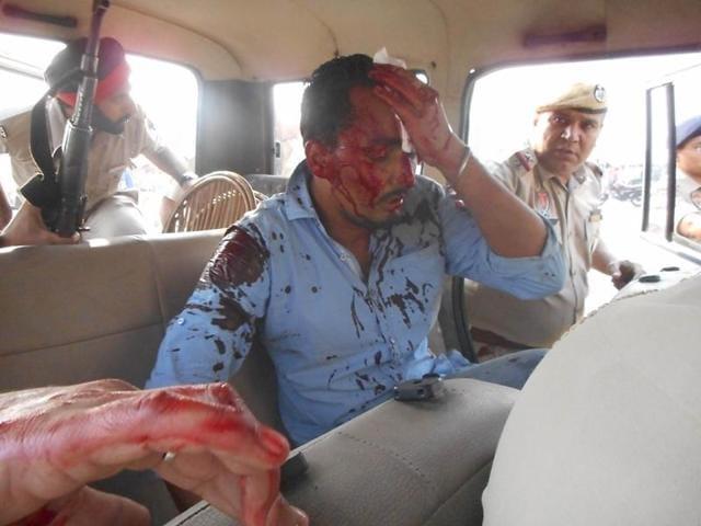 Police taking the injured cop, Jagmohan Singh, to a hospital at Kartarpur on Sunday.
