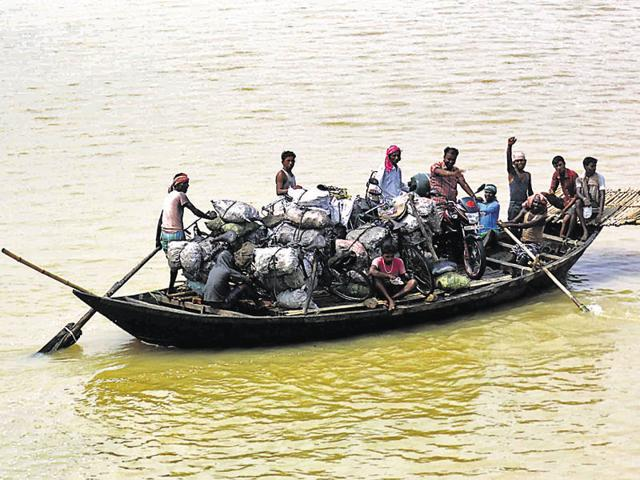 Sacks full of illegally procured coal being transported on boats via Maithon Dam to West Bengal.