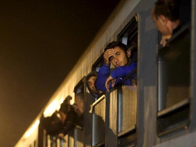 Migrants wait to exit a train at a station in Slovenia.