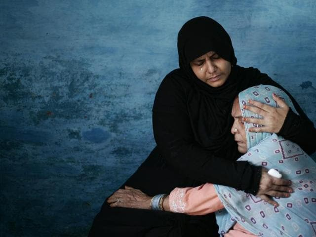 Asgari Begum (in blue), mother of Mohammad Ikhlaq, being consoled after her son was killed for allegedly slaughtering a cow in Bisada village of Greater Noida. An FIR was filed against 10 people for attacking his family.