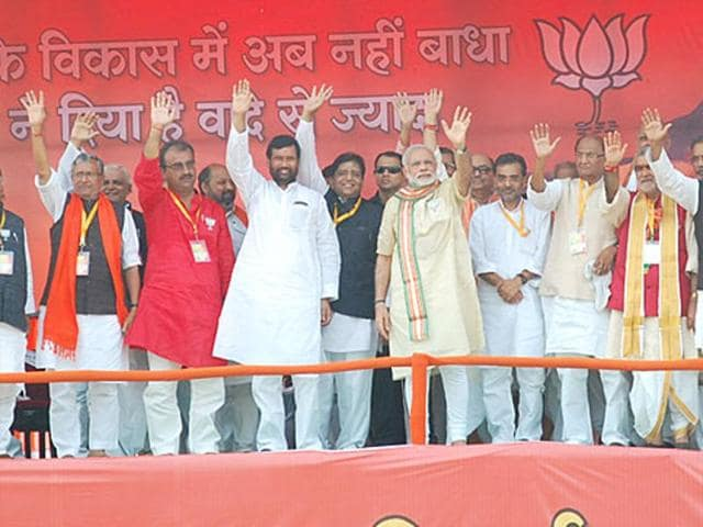 Narendra Modi and Bihar BJP leaders waving at the crowd during the Bhagalpur rally during a campaign for the Bihar Assembly elections.
