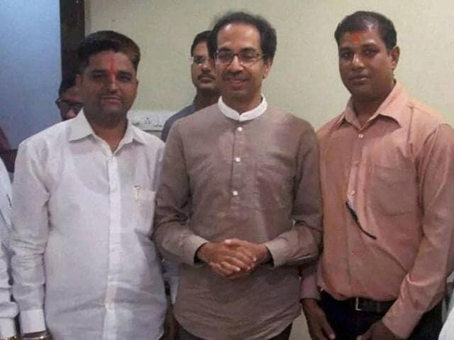 Shiv Sena chief Uddhav Thackeray meeting with Sena activists who had thrown ink on ORF chairman Sudheendra Kulkarni in Mumbai on Tuesday.