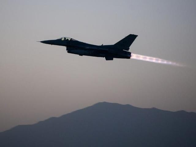 A US Air Force F-16 Fighting Falcon aircraft assigned to the 555th Expeditionary Fighter Squadron takes off on a combat sortie from Bagram Air Field.