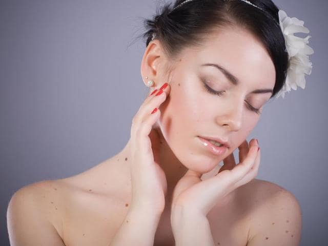 """Researchers say that women with more than 11 moles on their right arm were more likely to have over 100 on their body in total, a """"strong predictor"""" of melanoma."""