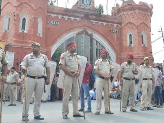 Police personnel stand guard outside Hall Gate in Amritsar on Monday.