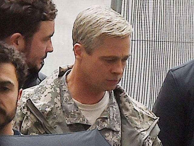 Brad Pitt was seen sporting grey hair and the 'rugged soldier' look.