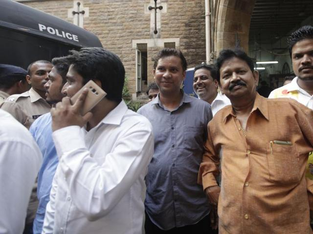Shiv Sena workers outside the court, after the attackers were granted bail on Monday.