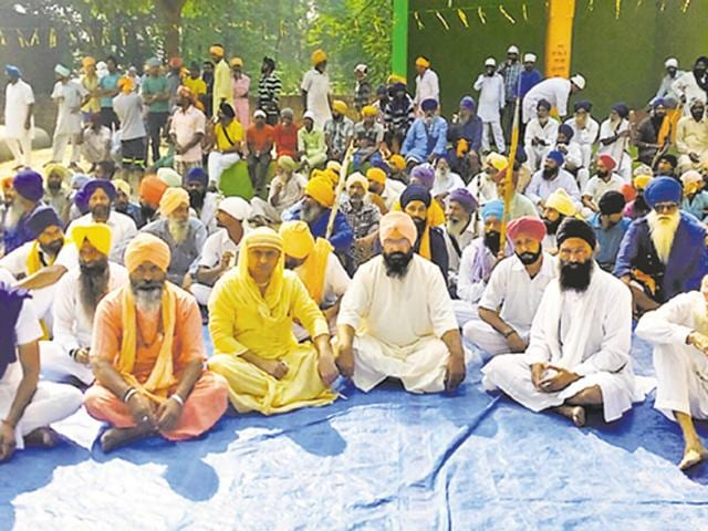 Sikhs protest against the alleged desecration of Guru Granth Sahib in Bathinda on Tuesday.