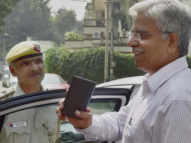 Delhi Police commissioner BS Bassi leaves after meeting Lt Governor Najeeb Jung in New Delhi on Tuesday.