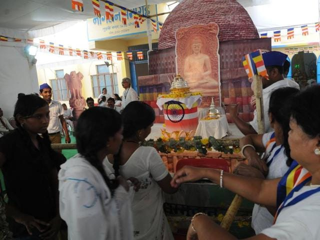 Devotees throng to have a glimpse of Buddha relics kept for Karuna Buddha Vihar in Bhopal on Monday.