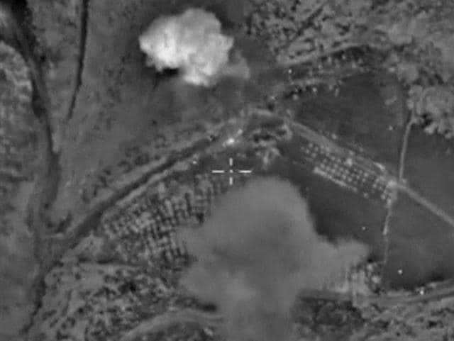 A frame grab taken from footage released by Russia's defence ministry October 19, 2015, shows what Russia says is smoke rising after air strikes carried out by the Russian air force on militant workshops near Sermania in Idlib province, Syria.