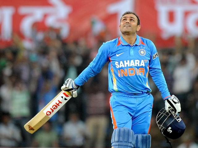 (FILES) In this photograph taken on December 8, 2011, Indian batsman Virender Sehwag looks up as he celebrates scoring a double century (200 runs) during the fourth one-day international cricket match between India and West Indies at The Holkar Stadium in Indore.