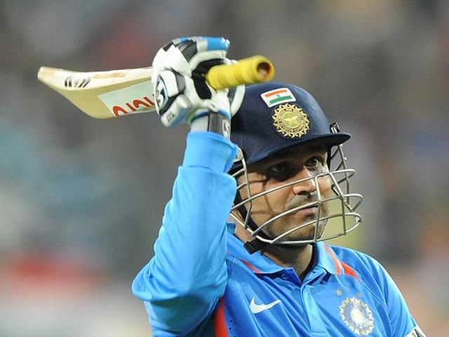 Sehwag walks back towards the pavilion after his dismissal during the fourth ODI between India and West Indies in Indore on December 8, 2011. Sehwag has announced his retirement.
