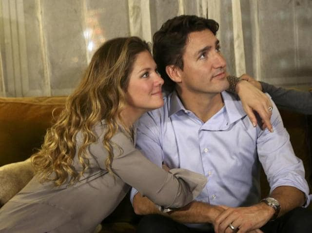 Liberal leader Justin Trudeau is embraced by his wife Sophie Gregoire as he watches election results at his election night headquarters in Montreal.