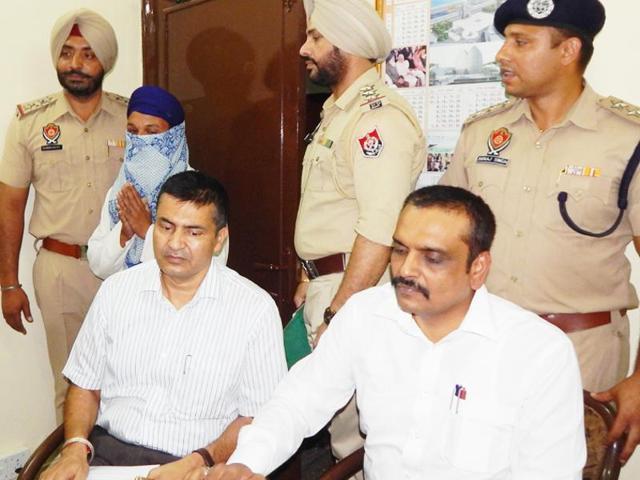 DIG Kunwar Vijay Pratap Singh and Tarn Taran SSP Manmohan Sharma addressing a during press conference in  Amritsar on Monday.