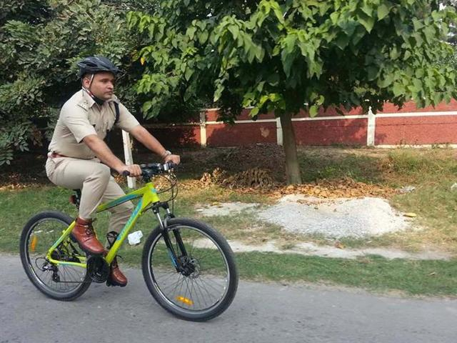 Karnal superintendent of police Pankaj Nain going to his office on a bicycle on Tuesday.