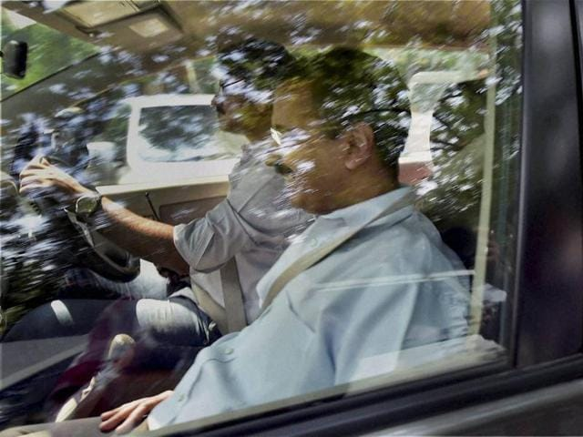 Delhi Chief Minister Arvind Kejriwal and Deputy CM Manish Sisodia leave after attending the swearing-in ceremony of their new colleague Imran Hussain at Rajniwas in New Delhi on Tuesday.