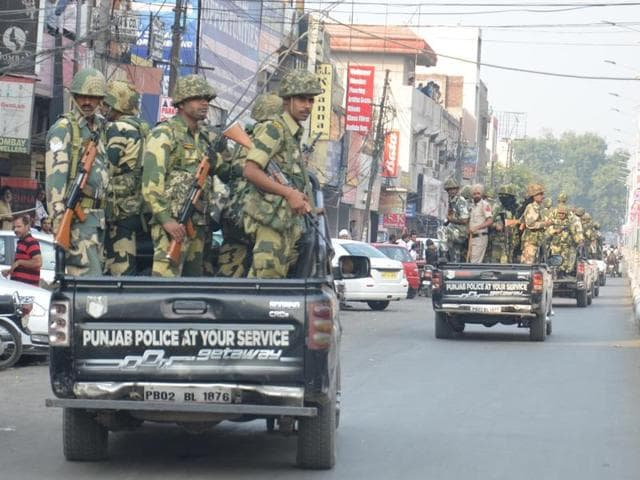 Border Security Force (BSF ) jawans and Punjab Police performing the flag march in Amritsar on Tuesday. Unrest has gripped parts of Punjab as protests continued.