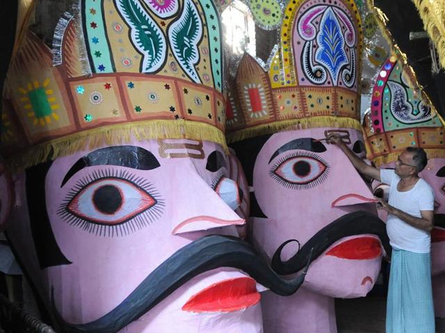 The artisan giving final touches to the effigies of Ravana, Meghnad and Kumbkarna in SAS Nagar on Monday.