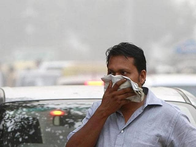 A dim haze caused by air pollution at Connaught Place in New Delhi on Monday.