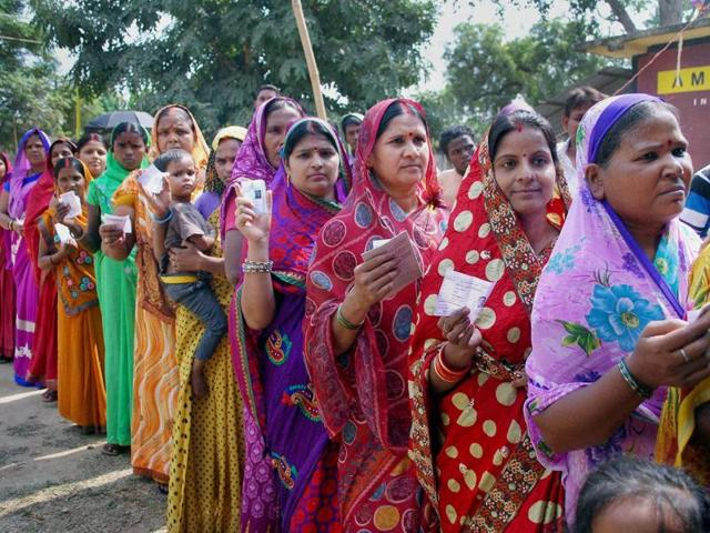 Voters wait in queue to cast their vote during the second phase of Bihar Assembly elections at Gaya on Friday.