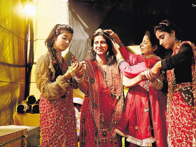(L-R) Kashish, Farhana Khan, Poonam Khan and Farah Khan, who play the roles of Surpnakha, Sita, Kaikeyi and Sabri, get ready backstage to perform in a Ramlila, in Greater Noida on Monday.