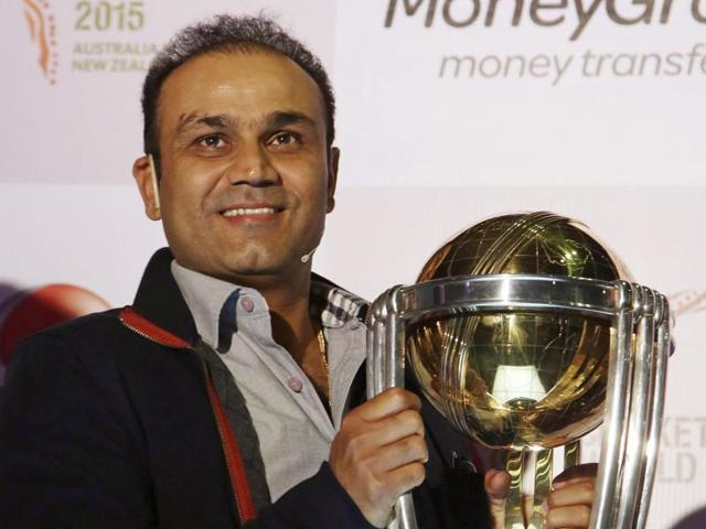 Virender Sehwag holds the ICC World Cup trophy.