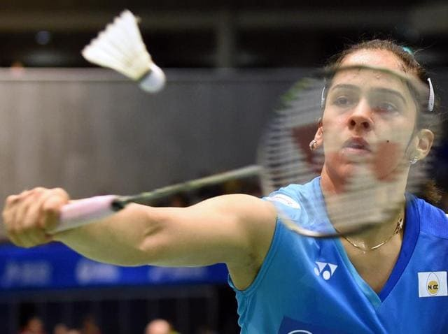Saina Nehwal progressed to the second round of the French Open Super Series with a win over Michelle Li of Canada.