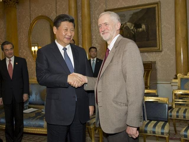 British opposition Labour Party leader, Jeremy Corbyn, (L) meets with China's President Xi Jinping at Buckingham Place in London on October 20, 2015, on the first official day of a state visit.
