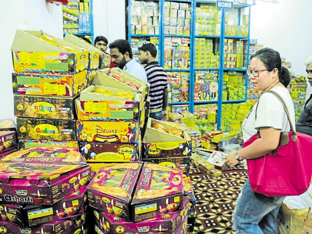 A customer shops for firecrackers at a wholesale shop in village Gadoli on Tuesday.