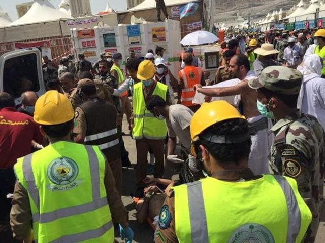 Members of Saudi civil defence try to rescue pilgrims following a crush caused by large numbers of people pushing at Mina, outside the Muslim holy city of Mecca in this handout picture.