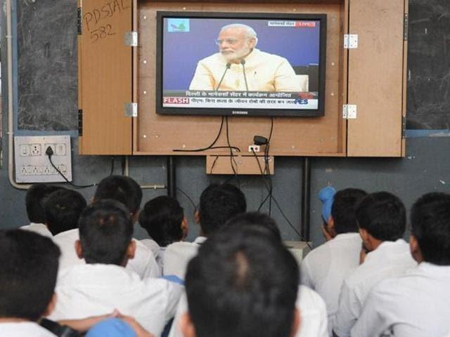 Students listening to Prime Minister Narendra Modi's 'Mann Ki Baat' programme at Government Senior Secondary School, Ladowali on Friday. (Pardeep Pandit/HT Photo)